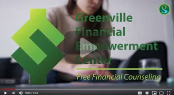 Greenville Financial Empowerment Center logo, with woman sitting in background filling out a form