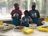 Youth of the Sterling Neighborhood present their edible creations at the September Neighborhood Association meeting.