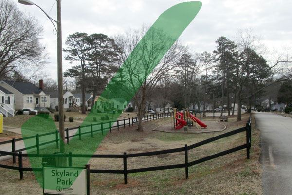 Fencing at Skyland Park with a green check box graphic indicating the project is complete