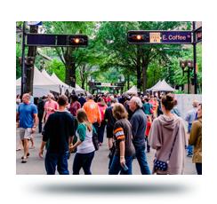 People walking down Main Street during a festival