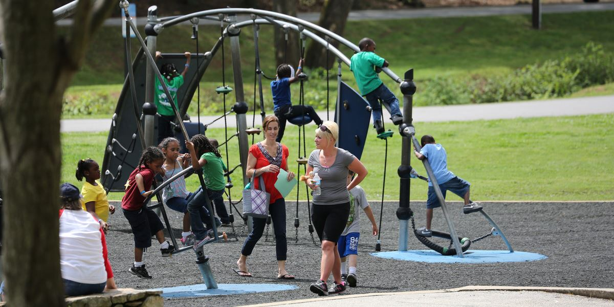 Children on playground equipment in Cleveland Park