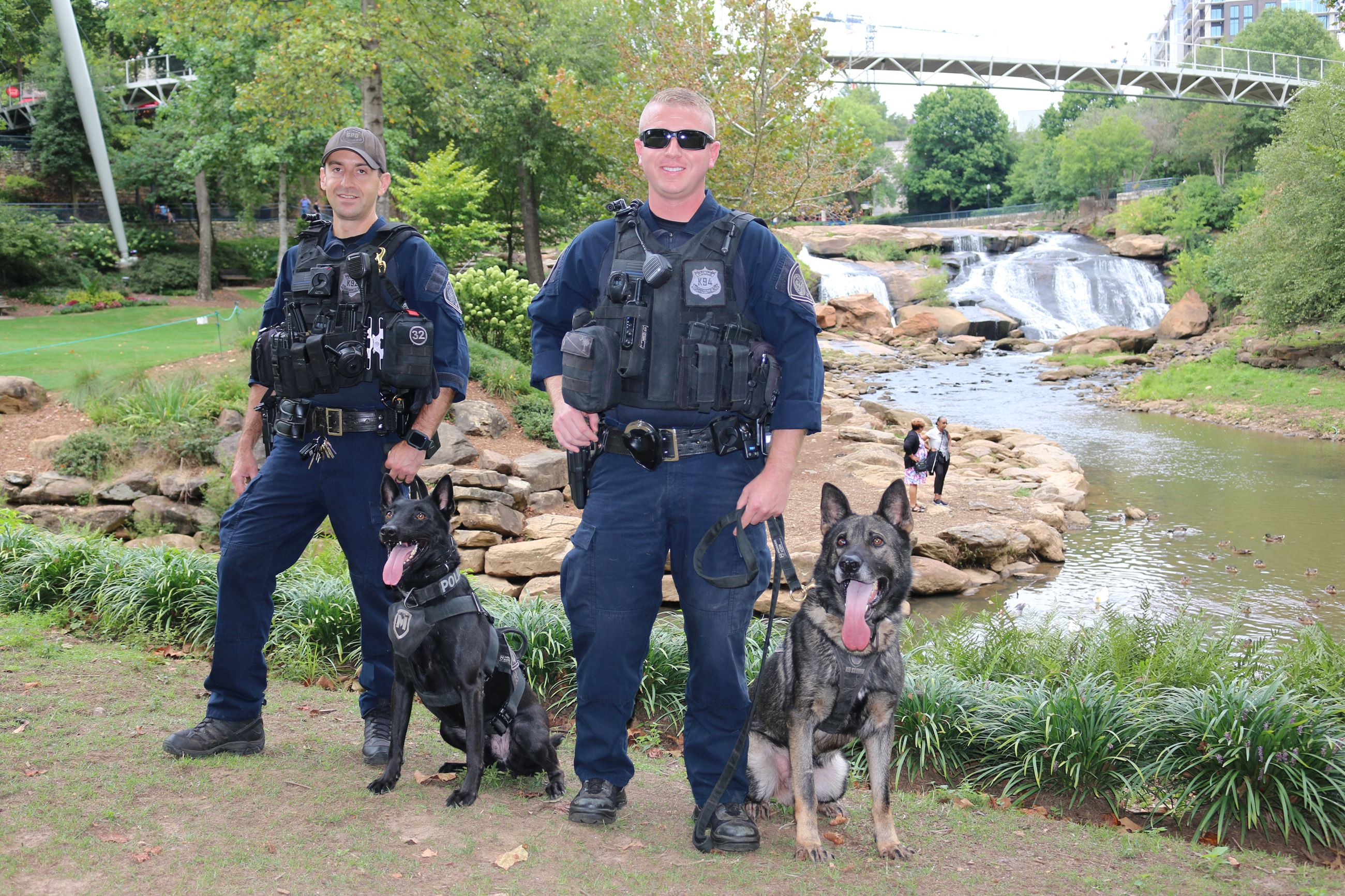 Officer Newman with K9 Sarge alongside Officer Weeks with Leo.