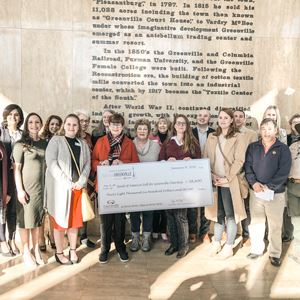 Nonprofit staffers joined FFG for a group photo in City Hall to celebrate their contribution to the