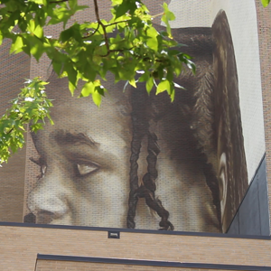Image of girl emerging on the College Street mural