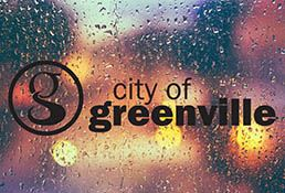 city logo on background of rainy day