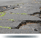 photo of cracked roadway in need of repair
