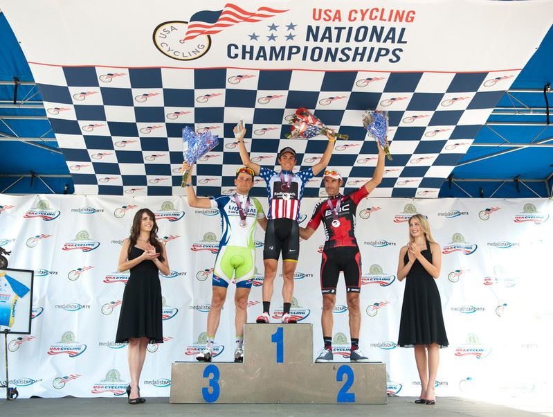 Winners' podium at bike race event.